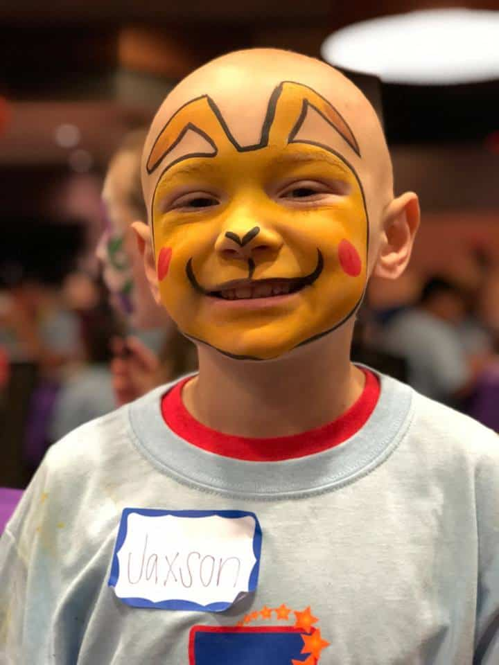 A pediatric cancer patient with a face painting.