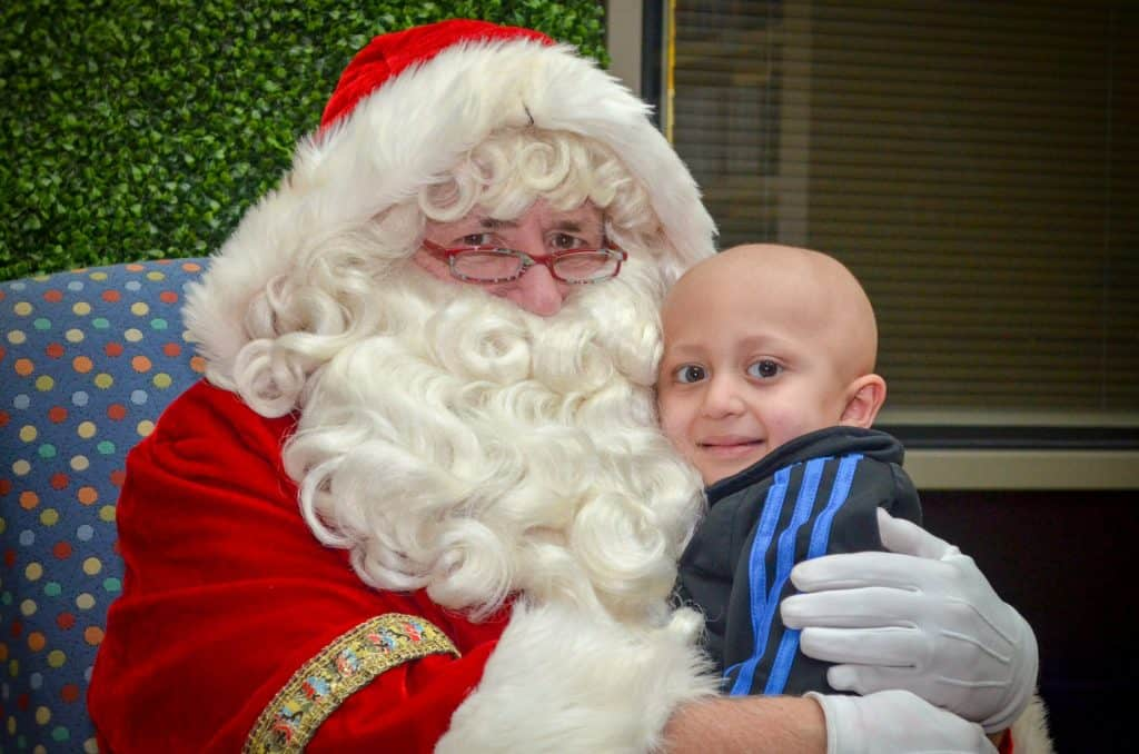 Santa Claus hugging a child.